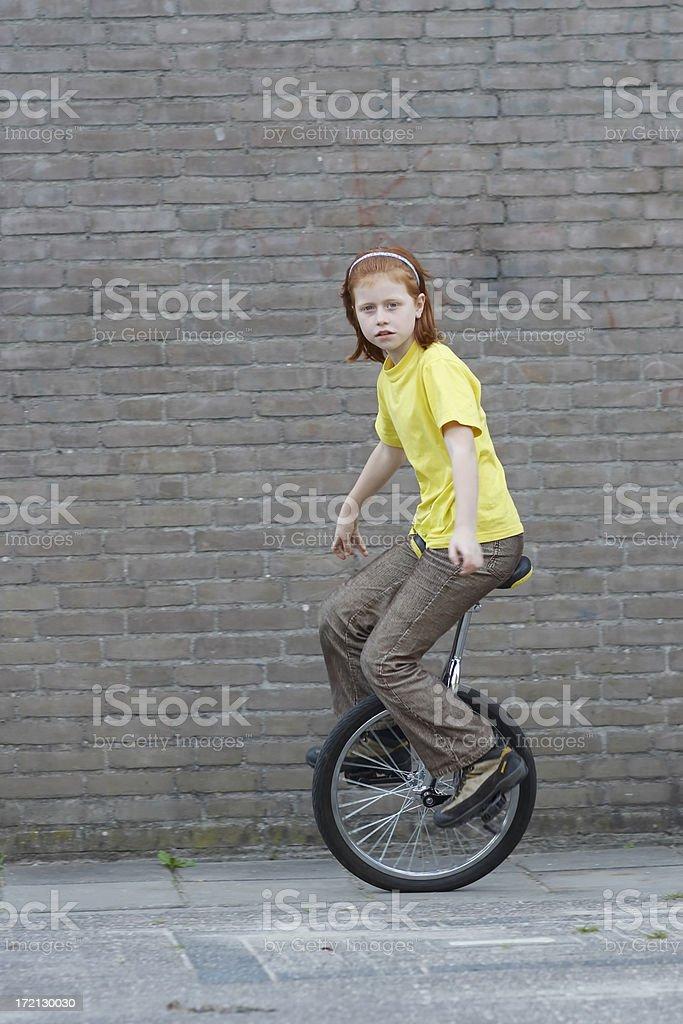 Unicycle girl stock photo