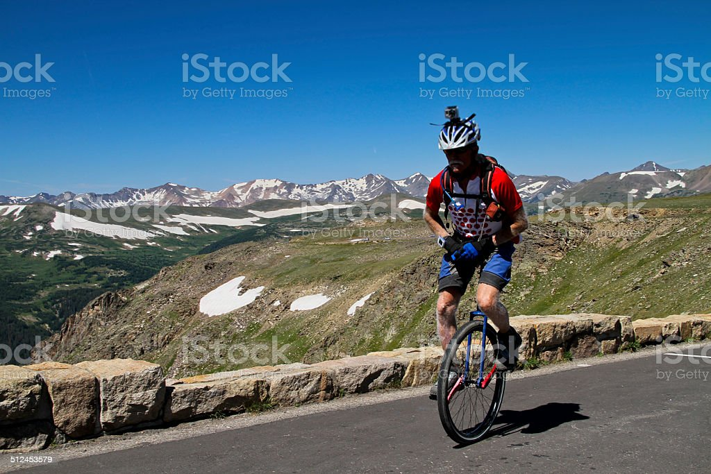 Unicycler On Trail Ridge Road stock photo