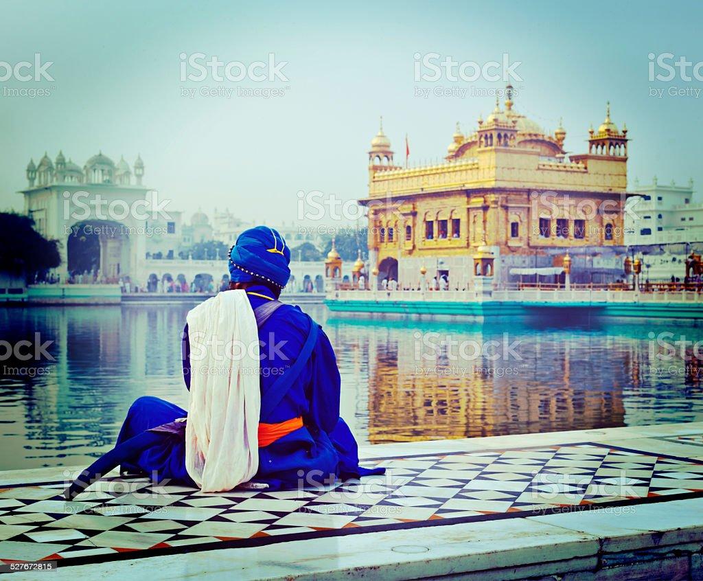 Unidentifiable Seekh Nihang warrior meditating at Sikh temple stock photo
