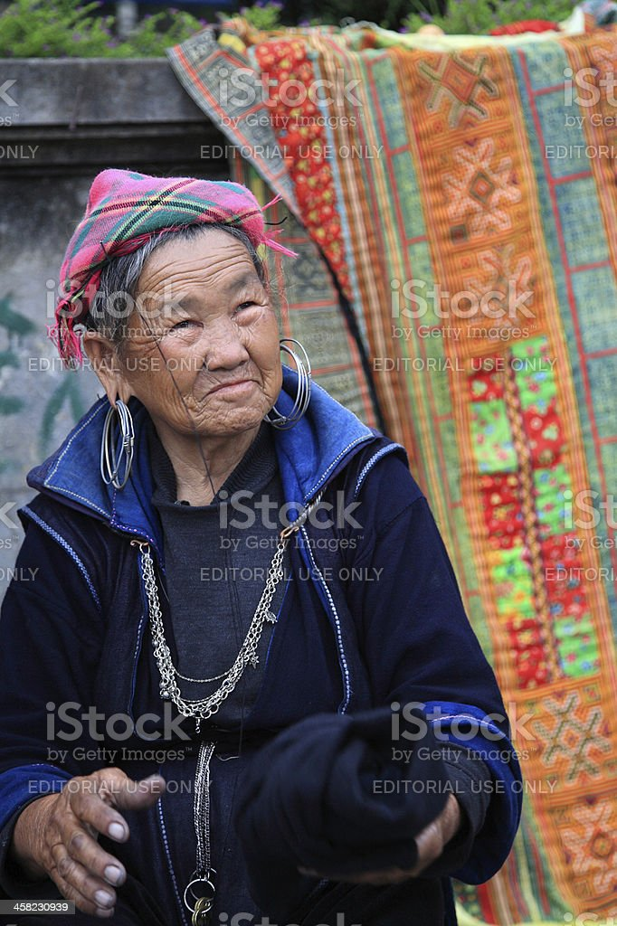 Unidentified Black Hmong's old woman sells textile royalty-free stock photo