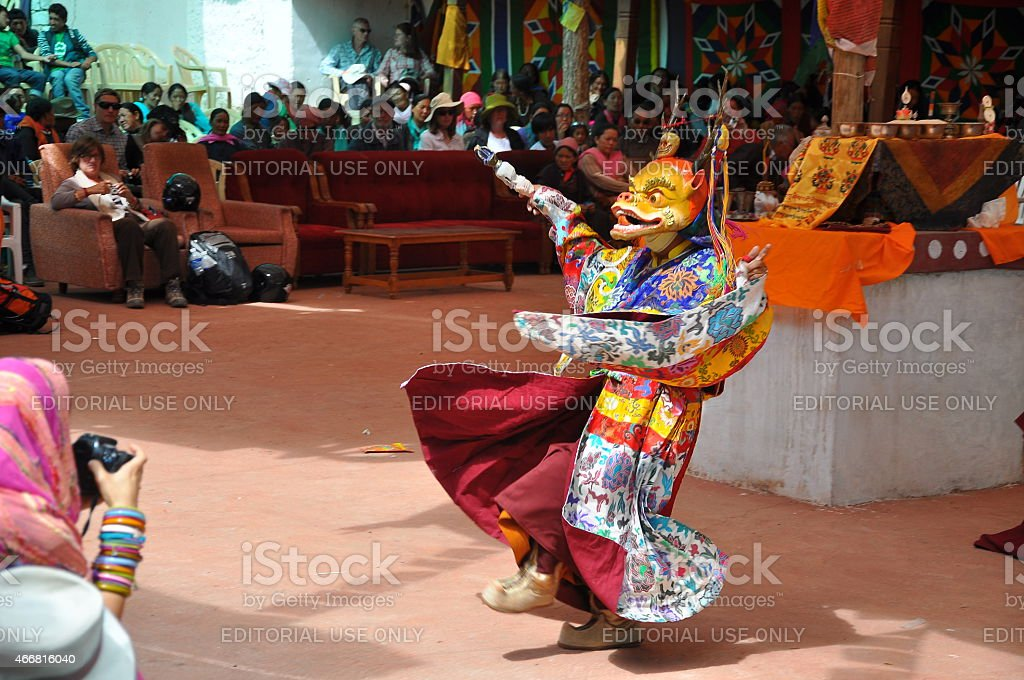 unidentified buddhist monk dancing during a mask festival stock photo