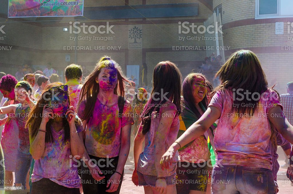 Unidentified colorful guys celebrating at the Festival of Colours stock photo