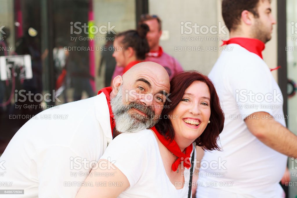 Unidentified couple poses in the San Fermin stock photo