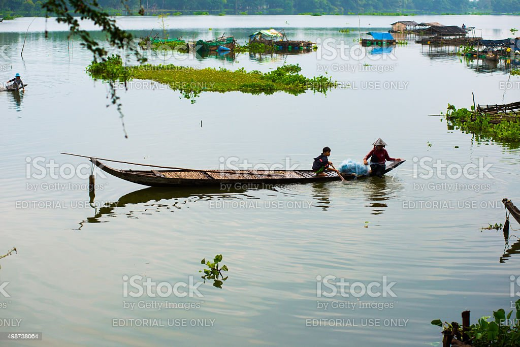 Unidentified fishers are in a lake in An giang, Vietnam. stock photo