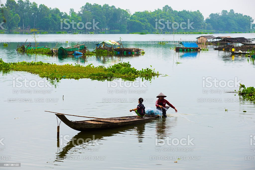 Unidentified fishers are in a lake in An giang, Vietnam stock photo