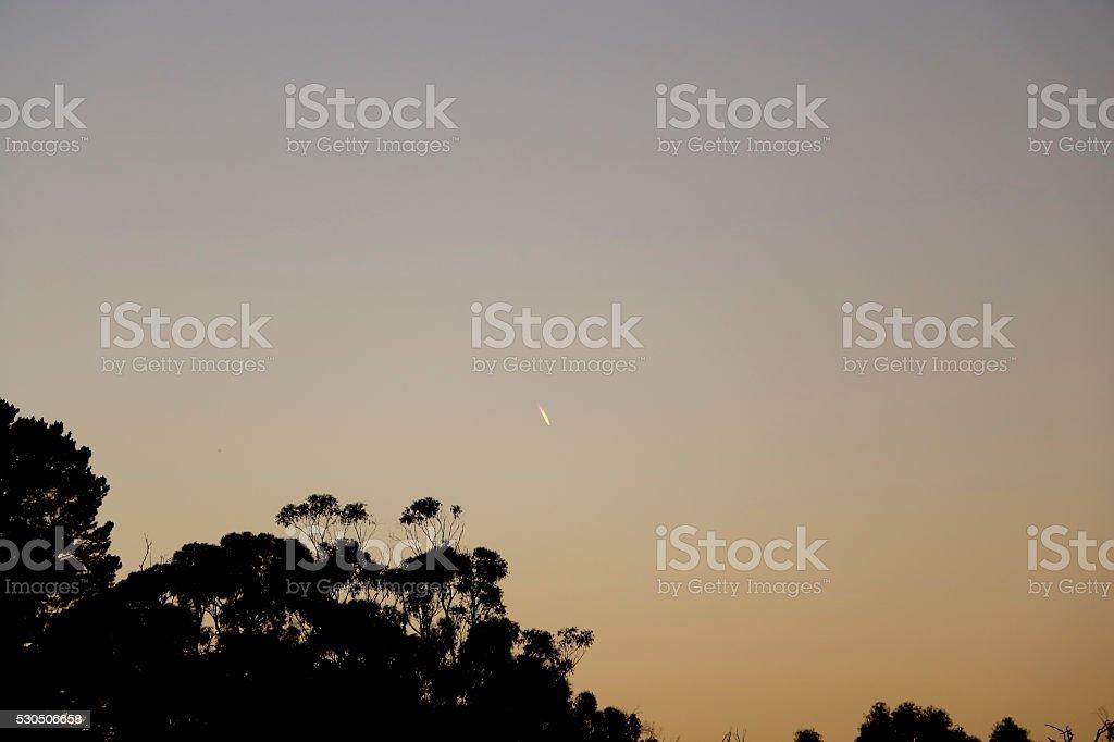 Unidentified Flying Object Burning in Morning Twilight Sky stock photo