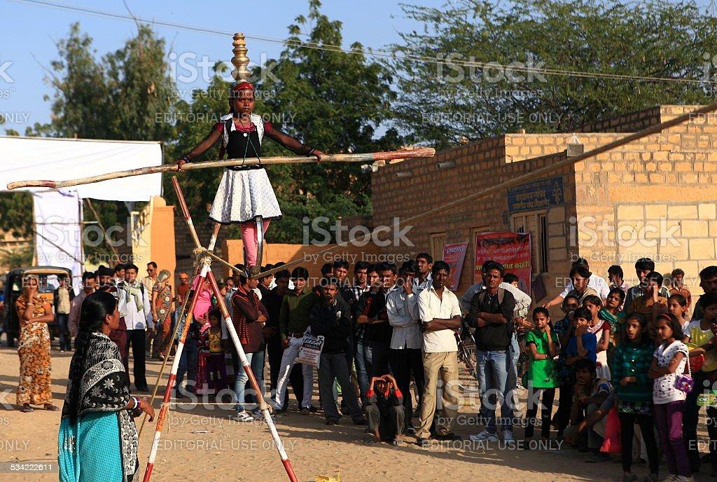 Unidentified girl performs an acrobat in Jaisalmer, India. stock photo