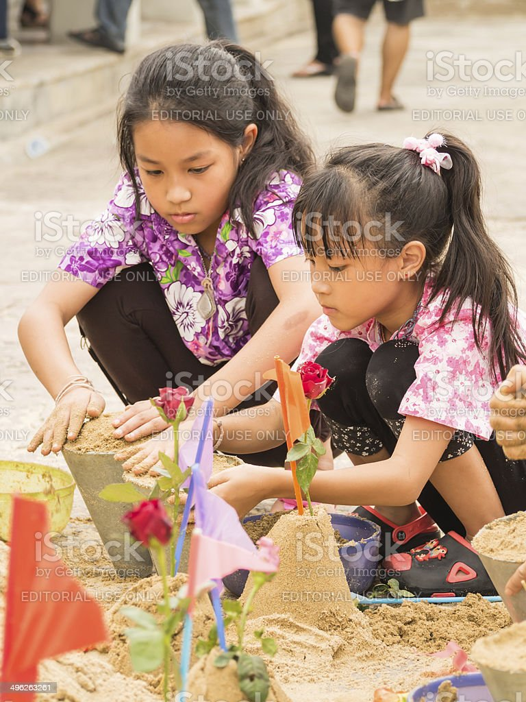 Unidentified girls making sand pagodas in Songkran Festival stock photo