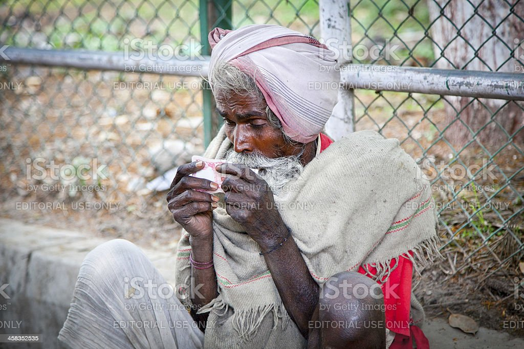 Unidentified homeless person begs on the street in Kathmandu, Nepal royalty-free stock photo