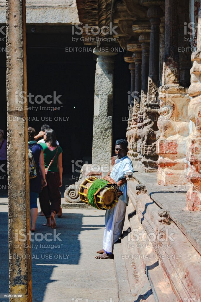 Unidentified Indian man with a drum standing in the courtyard of the Virupaksha temple stock photo