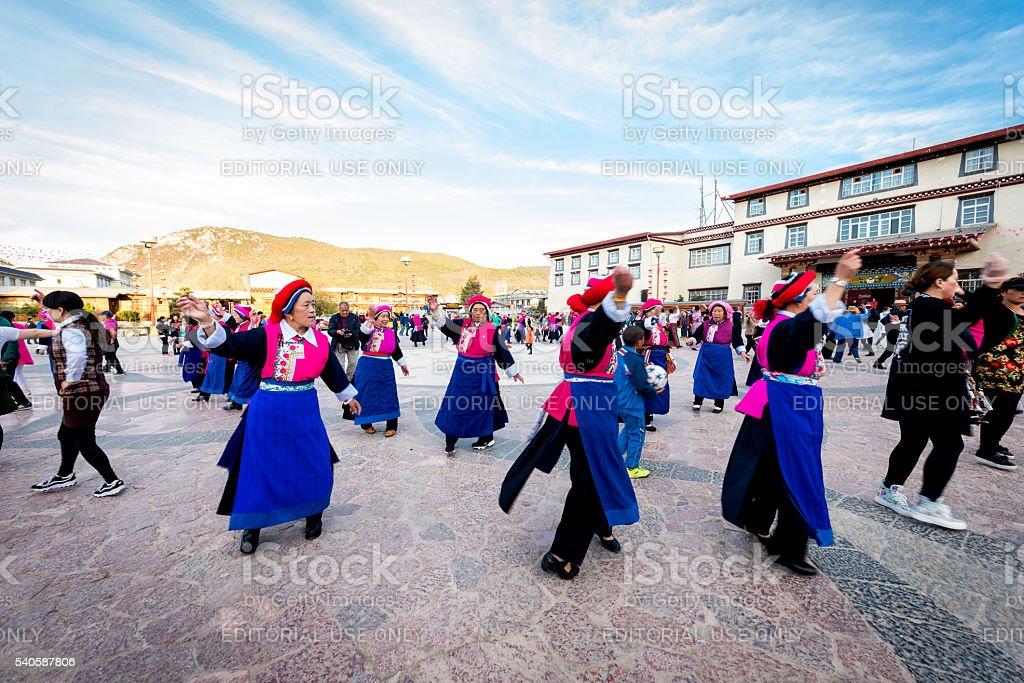 Unidentified indigenous women dance in Guishan Park stock photo
