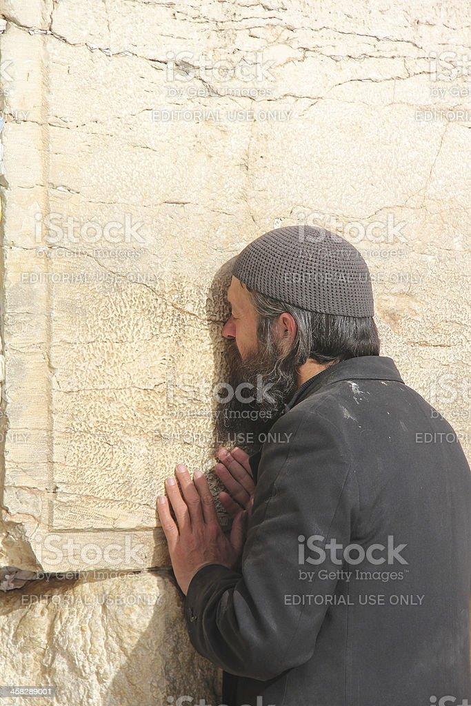 Unidentified jewish man prays at the Western wall royalty-free stock photo