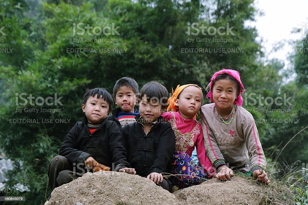 Unidentified kids in mountainous district of Dong Van stock photo