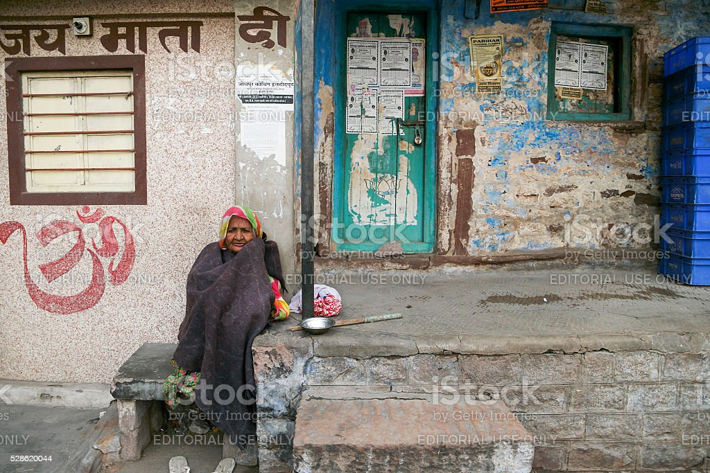 Unidentified local people aouside her house in the street stock photo