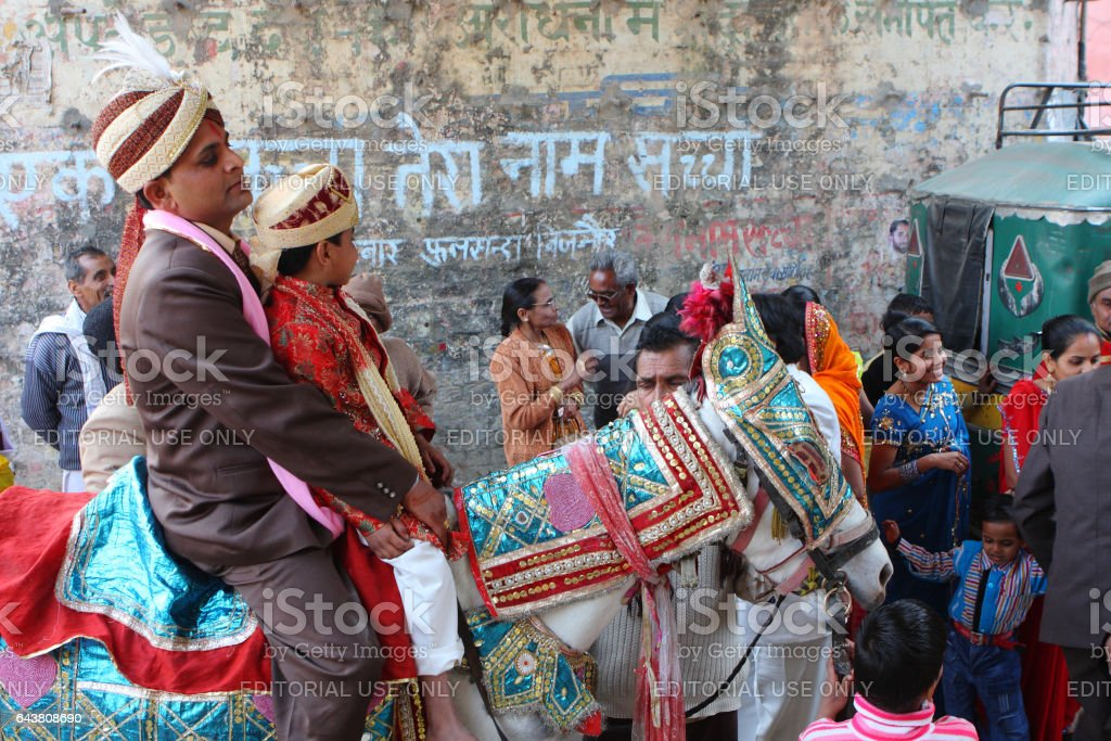 HARIDWAR, INDIA - JAN 14, 2009: Unidentified local people during traditional Indian Hindu wedding. India celebrates about 10 million weddings per year, of which about 80% are Hindu weddings. stock photo