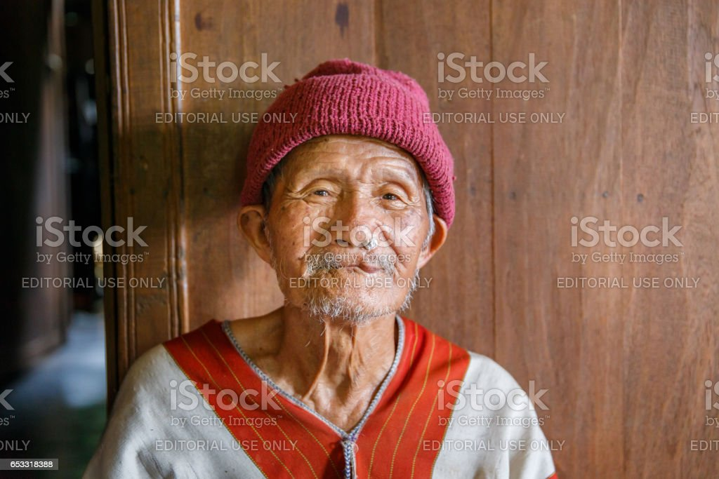 MAE KAM PONG, MAEHONGSON, THAILAND - October 10, 2015 : unidentified man Karen hill tribe is smiling in the cottage of northern Thailand on October 10, 2015 in Maehongson, Thailand. stock photo