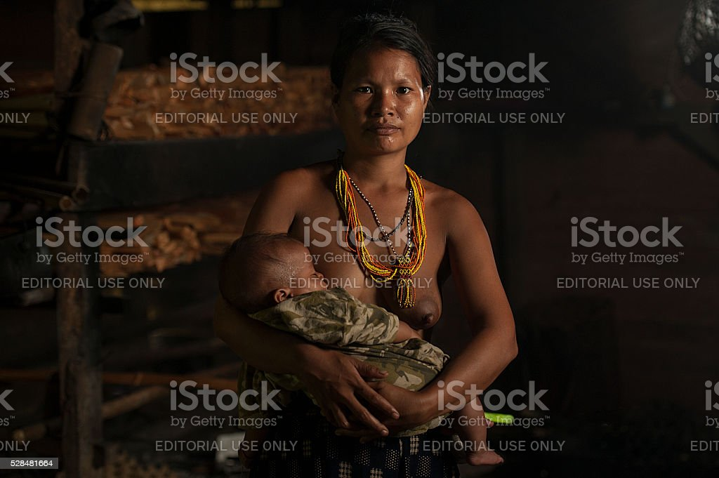 Unidentified Mentawai women with her child. stock photo