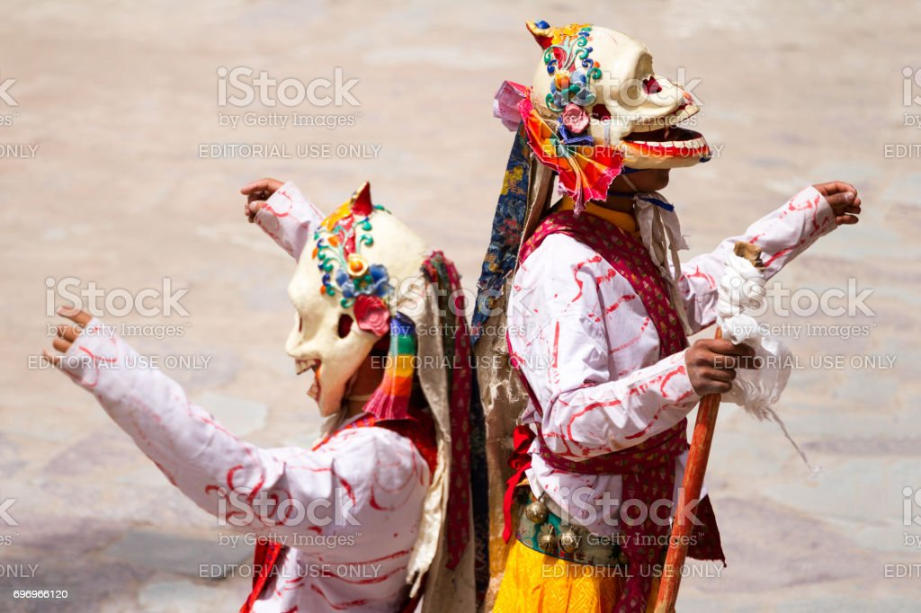 Unidentified monks in a skeleton costumes performs a religious masked and costumed mystery dance of Tibetan Buddhism during the Cham Dance Festival stock photo