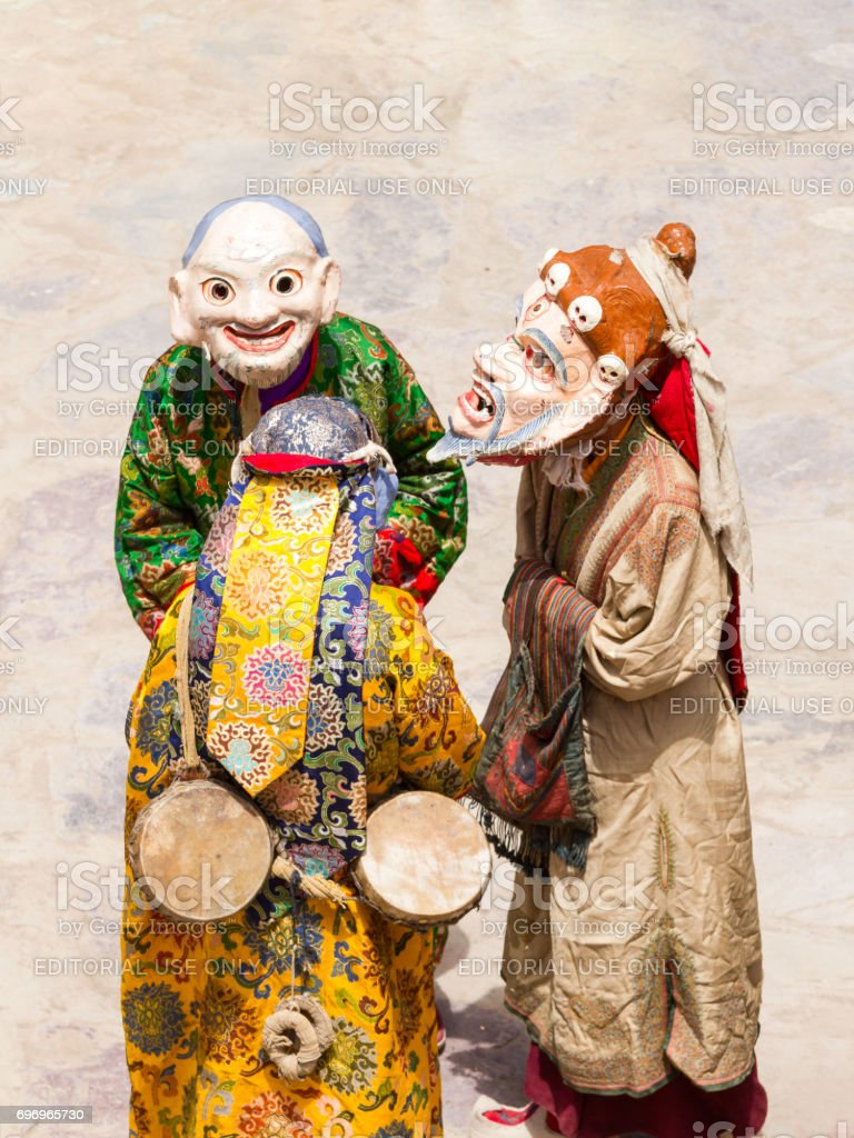 Unidentified monks in ritual masks perform a religious masked and costumed mystery dance of Tibetan Buddhism during the Cham Dance Festival stock photo