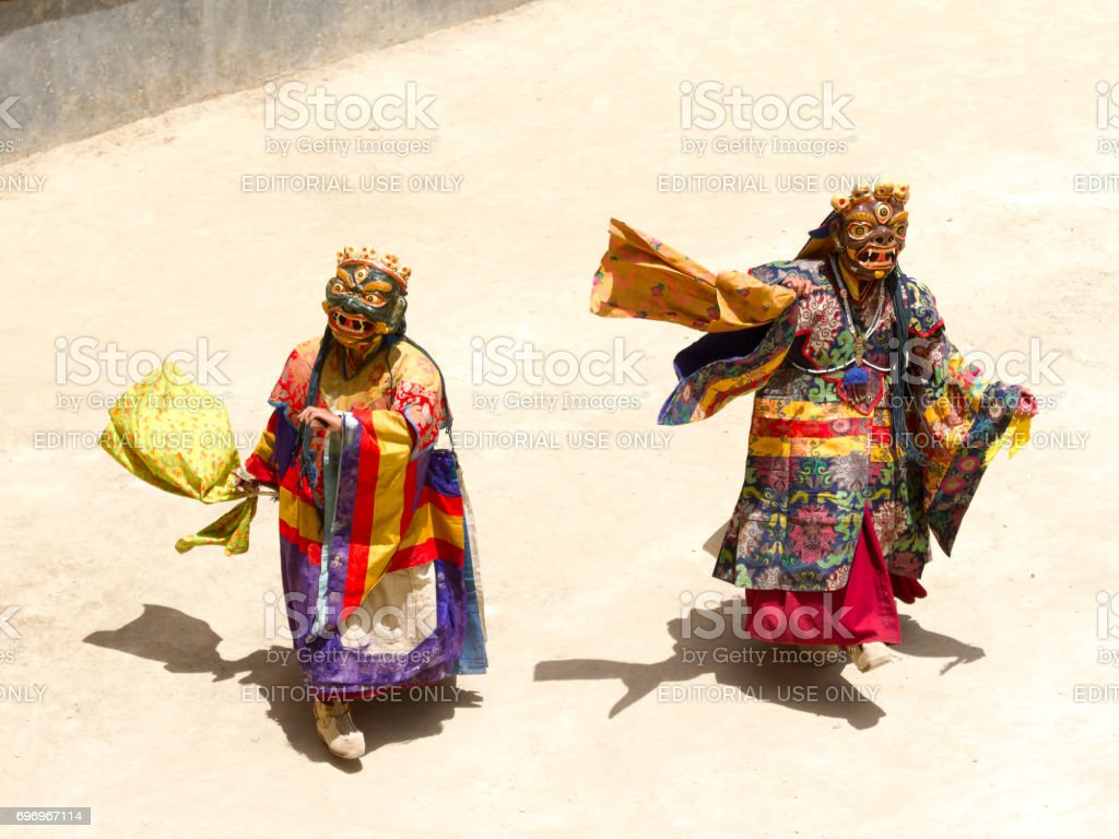 Unidentified monks perform a religious masked and costumed mystery dance of Tibetan Buddhism during the Cham Dance Festival stock photo