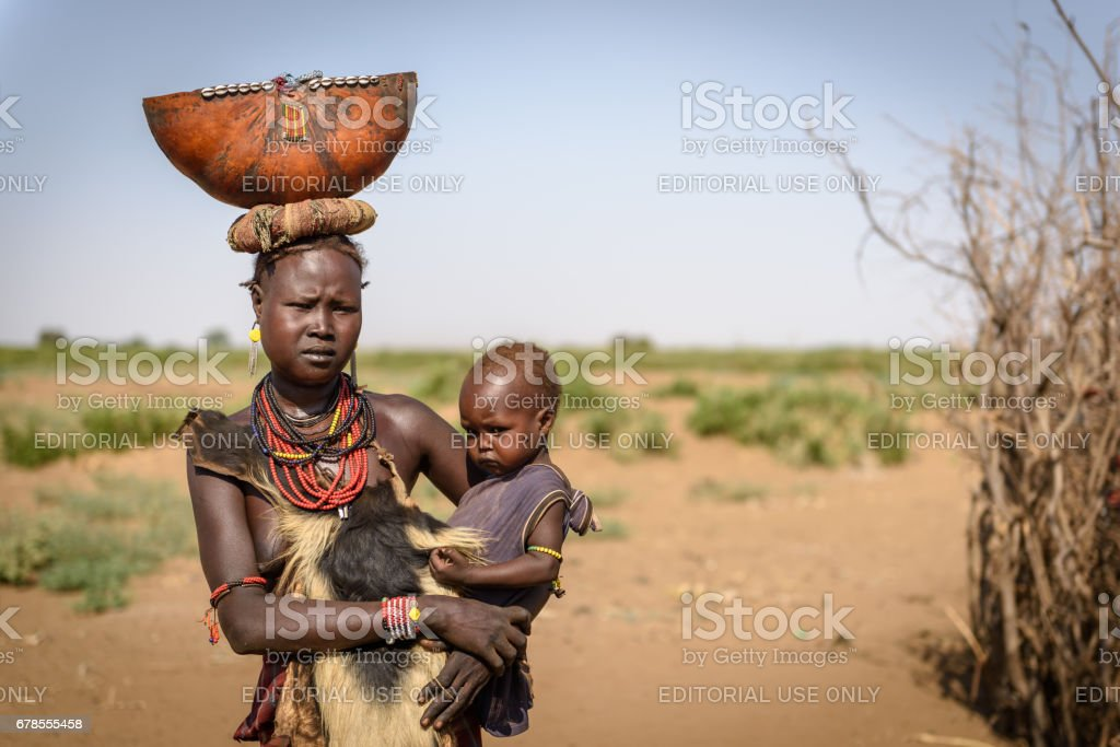 Unidentified Mother with her child from Dassenach tribe, Omo Valley, Ethiopia stock photo