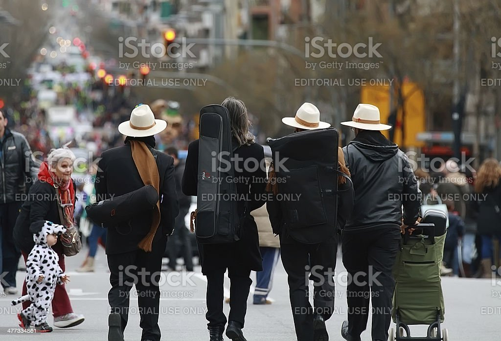 Unidentified musicians walking in the middle of Sants Street stock photo