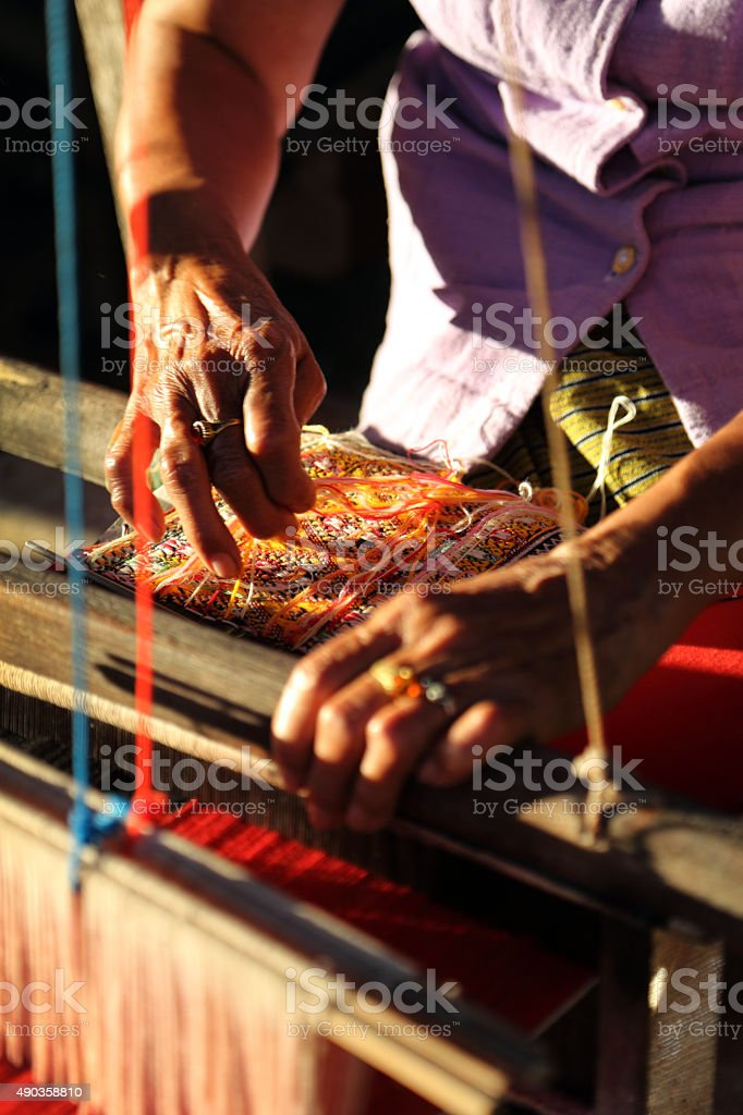 Unidentified old women weaving traditional thai fabric, Chiang M stock photo