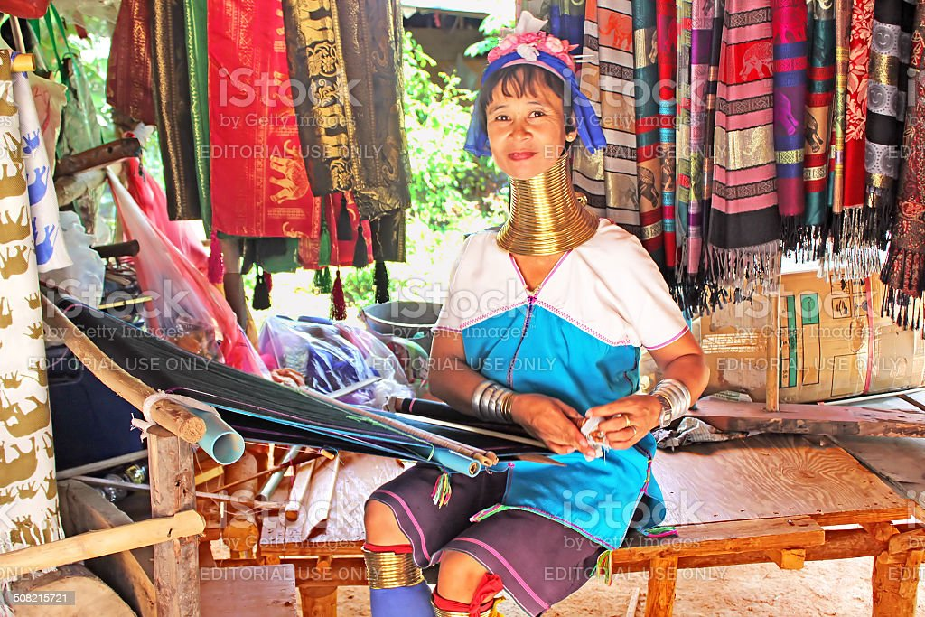 Unidentified Padaung (Karen) tribe woman weave on traditional device stock photo