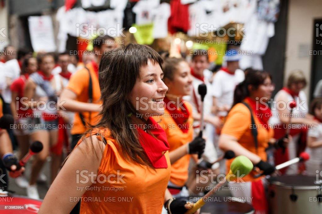 Unidentified people in a popular batucada by the streets of Pamplona in the celebrations of San Fermin. Fun is on the street stock photo