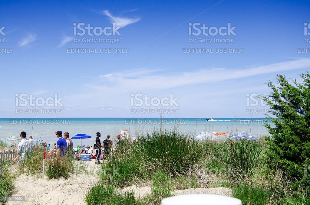 Unidentified people in the beach of Grand Bend in summertime stock photo
