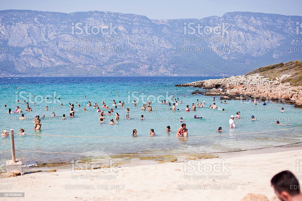 Unidentified people relaxing on  beach of Cleopatra in  Aegean Sea stock photo
