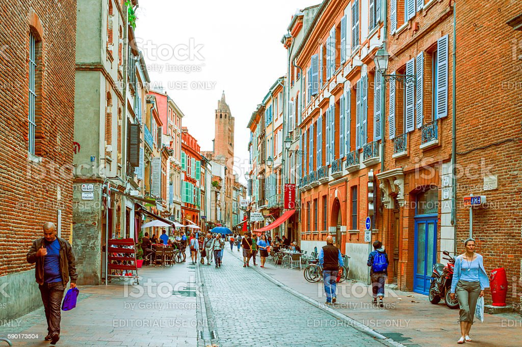 unidentified people walk along the streets of Toulouse stock photo