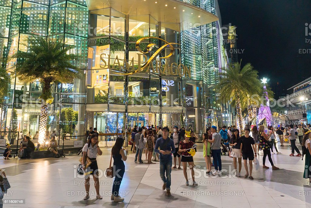 unidentified people walk at Siam Paragon shopping mall stock photo