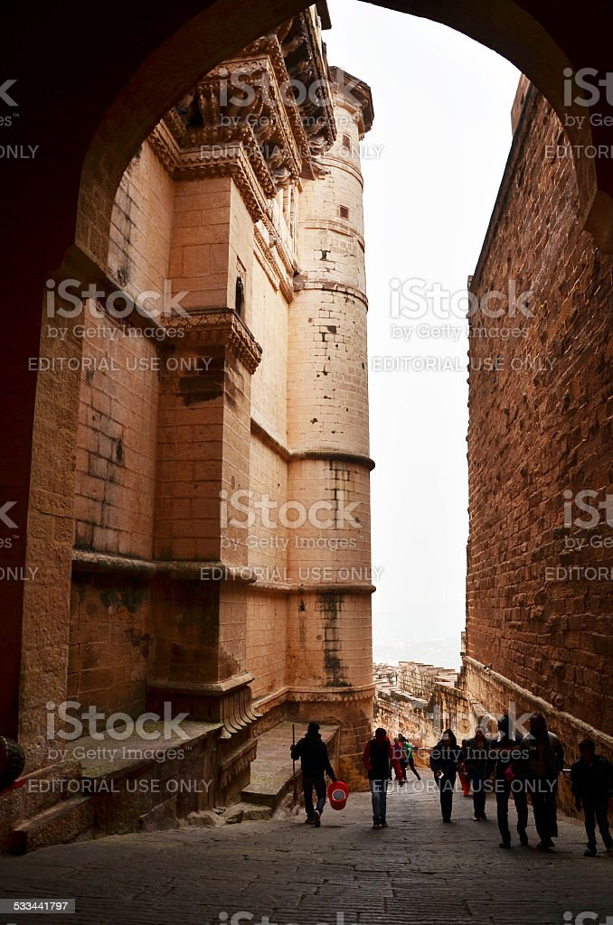 Unidentified people walk through a gate at Mehrangarh Fort stock photo