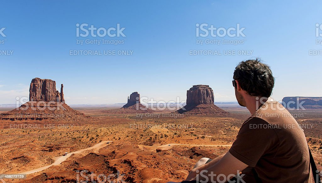 Unidentified person looks at Monument Valley in Utah. royalty-free stock photo