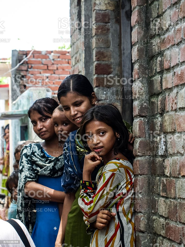 Unidentified poor people living in slum stock photo