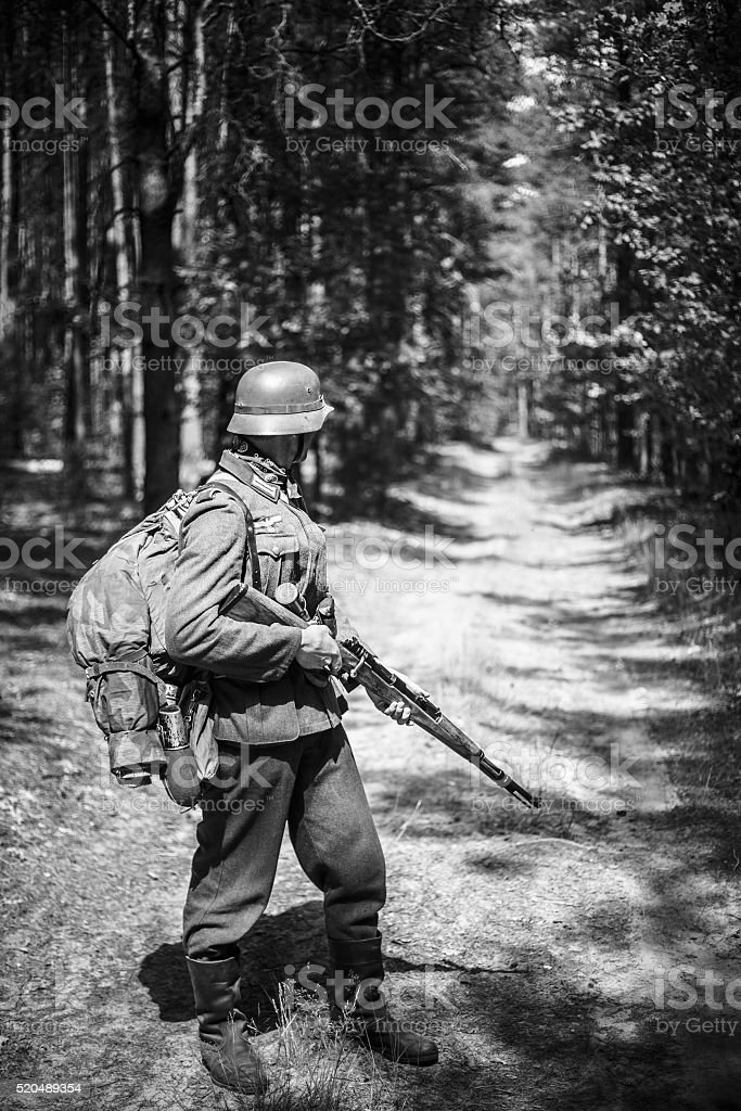 Unidentified re-enactor dressed as German soldier with rifle stock photo