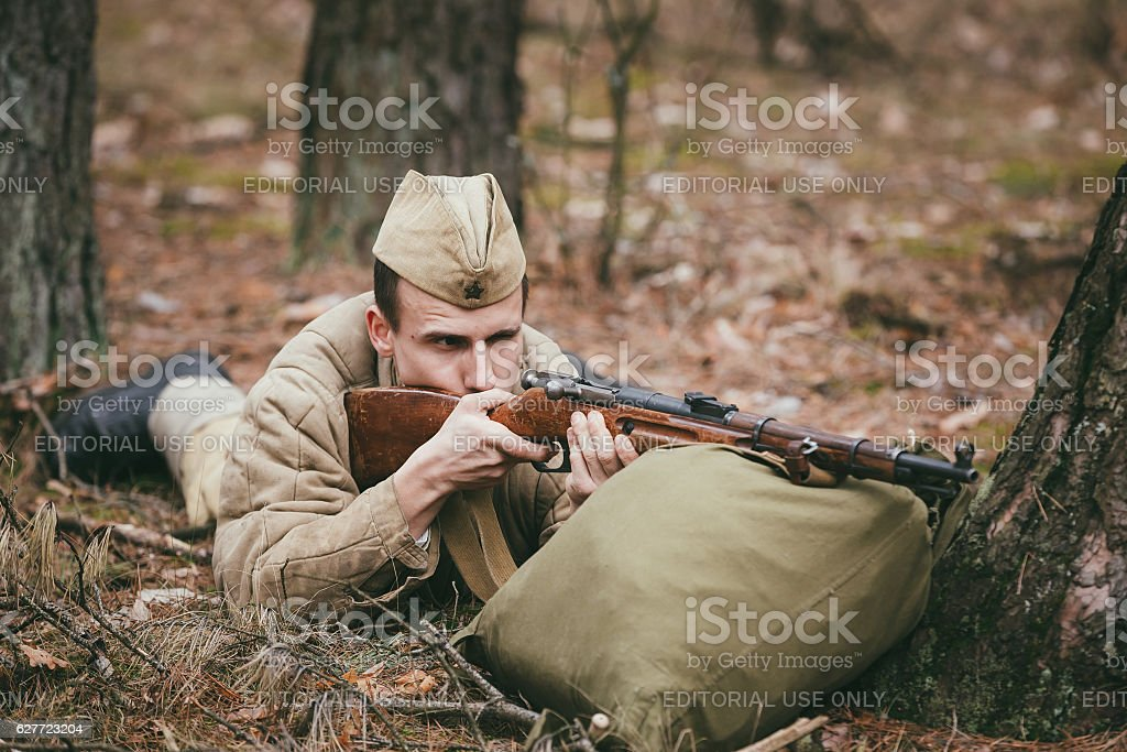 Unidentified re-enactor dressed as Soviet russian soldier aiming stock photo