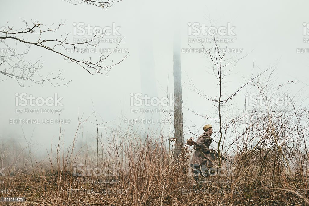 Unidentified re-enactor dressed as Soviet russian soldier running stock photo