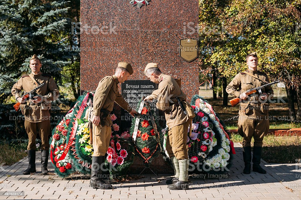 Unidentified re-enactors dressed as Soviet soldiers laying of wr stock photo