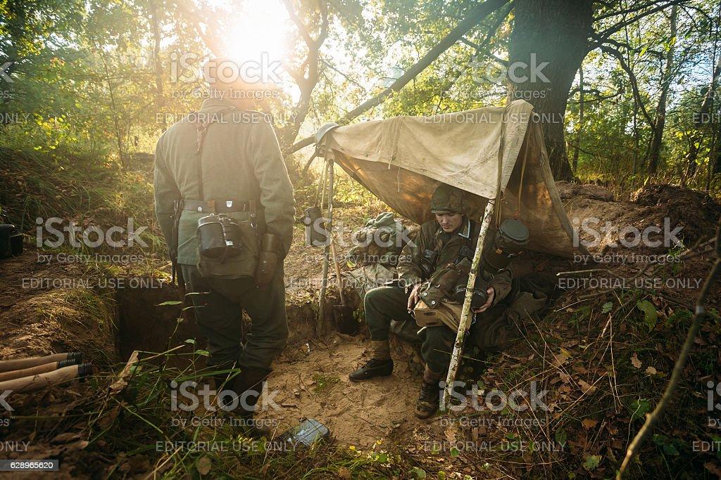Unidentified re-enactors dressed as World War II German soldiers stock photo