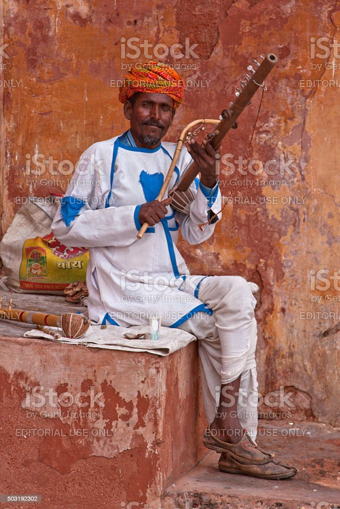 Unidentified street musician with a traditional Indian stringed instrument stock photo