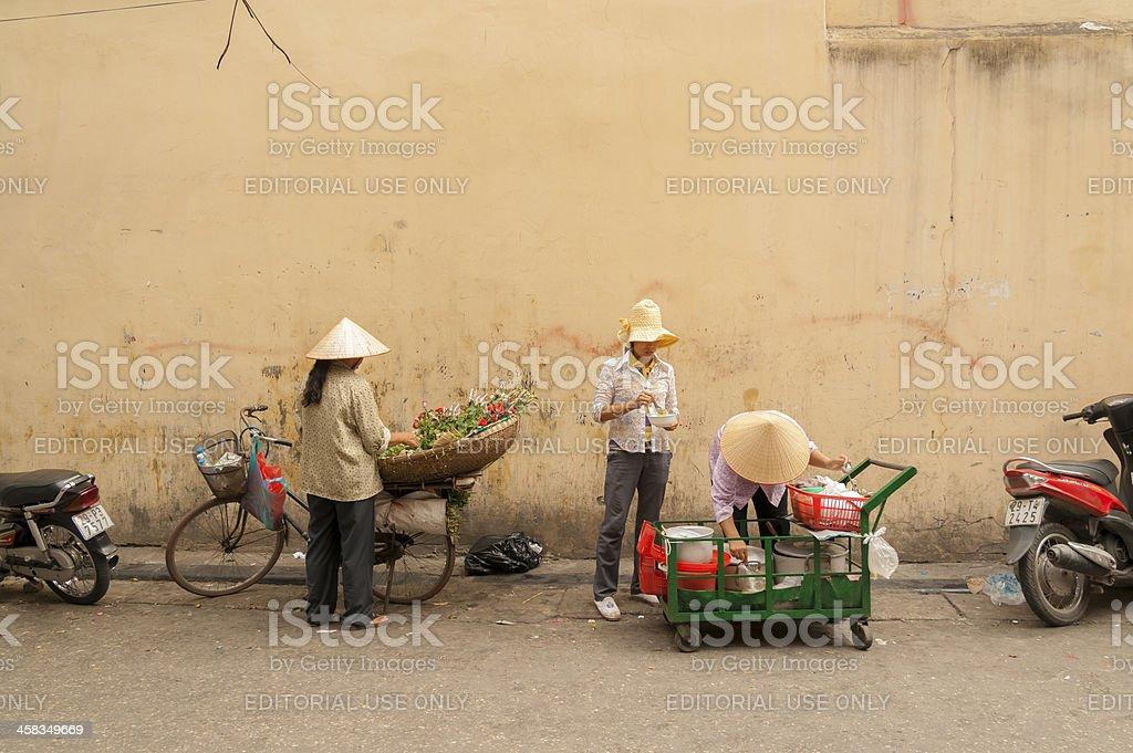 Unidentified street vendors in Hanoi on Sep 28, 2011 stock photo