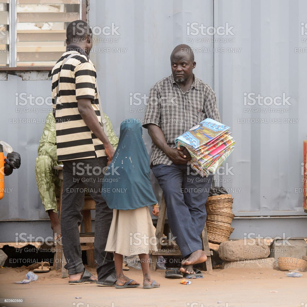 LOME, TOGO - Jan 9, 2017: Unidentified Togolese group of people talk about something. Togo people suffer of poverty due to the bad economy stock photo