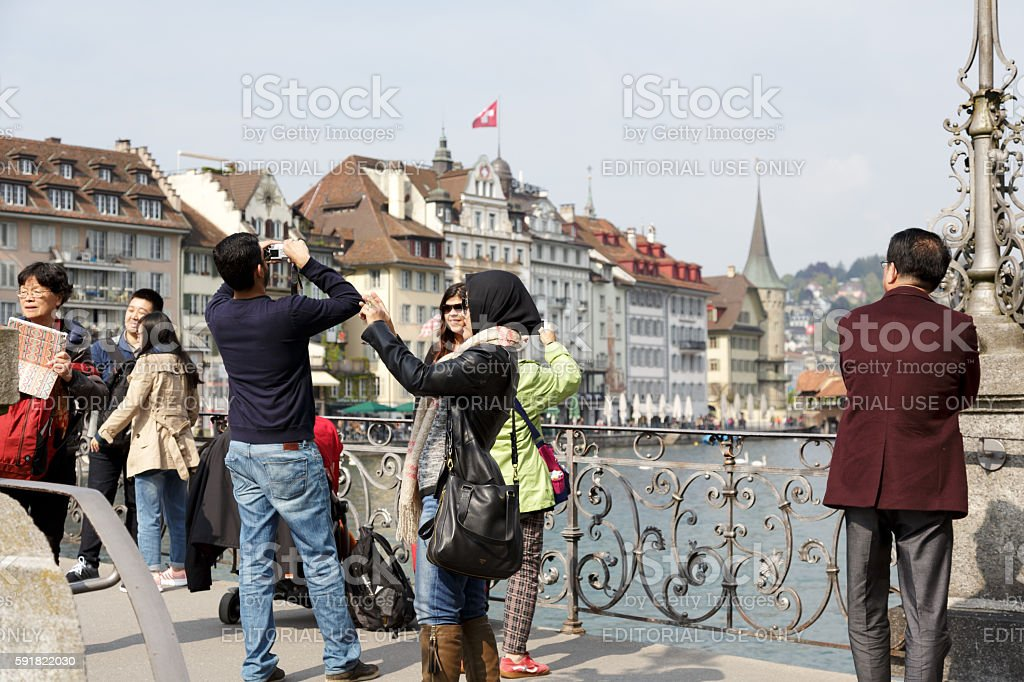 Unidentified tourists takes pictures in Lucerne stock photo