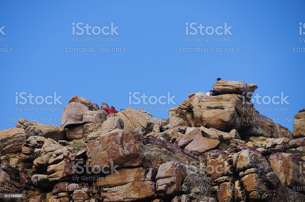 Unidentified tourists visit the top at Cape of Good Hope. stock photo