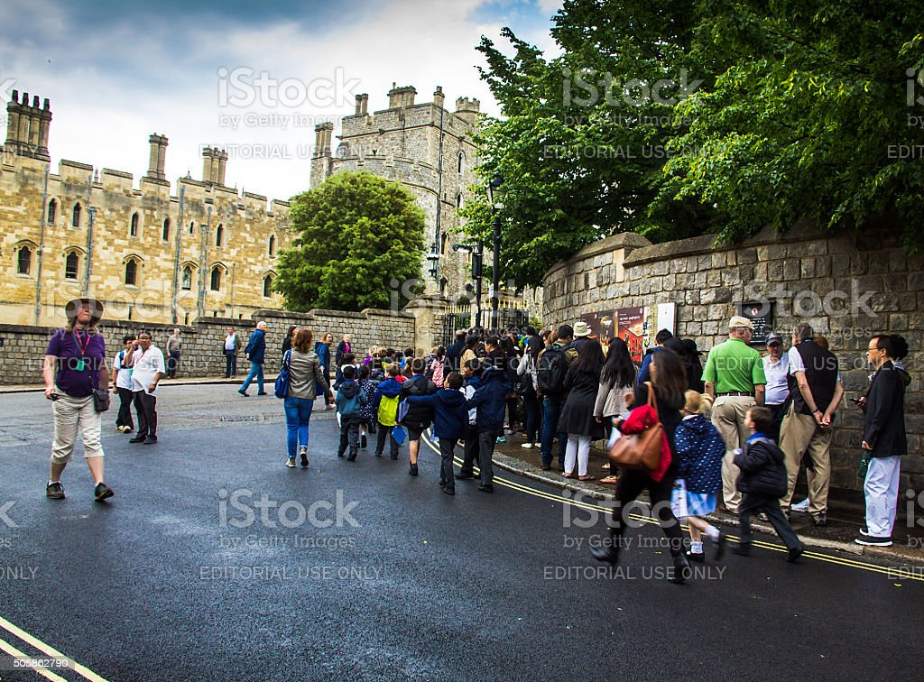 Unidentified visitors queuing in front of the  Windsor Castle. UK stock photo