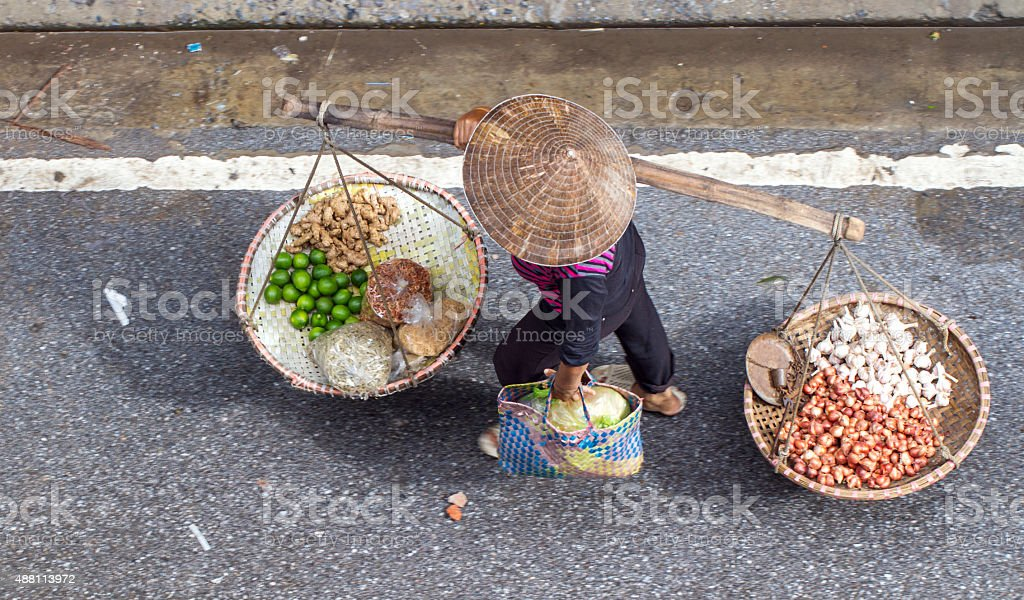 unidentified woman in the street retail stock photo