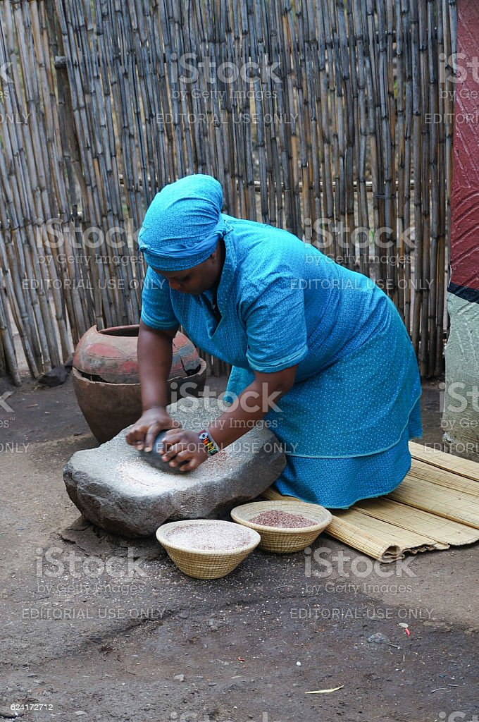 Unidentified woman made local beer with wheat,South Africa. stock photo