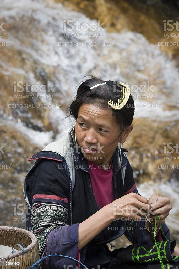 unidentified woman of Black Hmong ethnic minority embroiders royalty-free stock photo